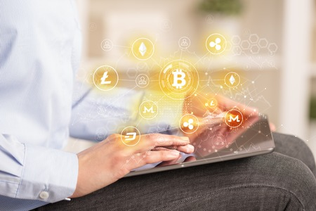 Business woman using tablet with bitcoin link network concept Фото со стока - 111080843