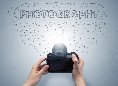 Hand photo shooting with message cloud concept Фото со стока