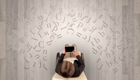 Letters with woman using laptop in a chair Stock Photo