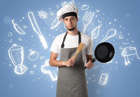 Young cook with chalk drawn soup recipe concept Stock Photo