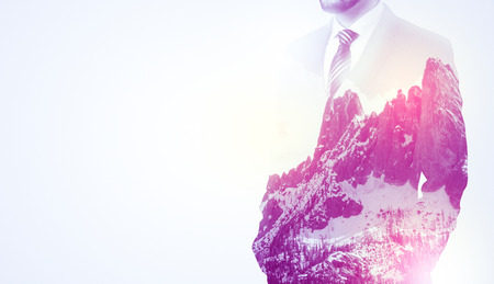 Businessman standing with mountain graphic