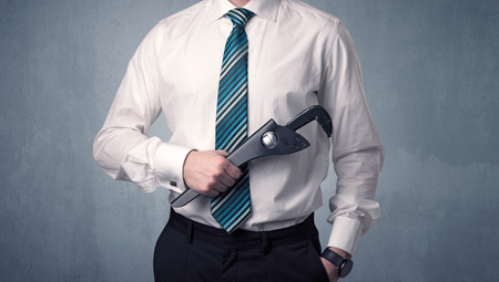 Businesman standing with tool on his hand