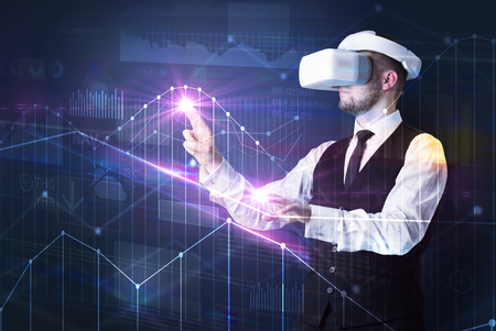 Man standing with VR goggles and graphs charts