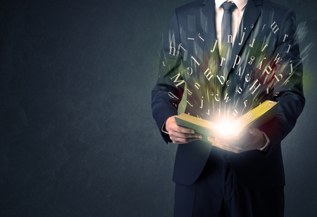 Businessman holding a book.