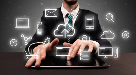 Businessman in suit typing with multimedia concept Imagens