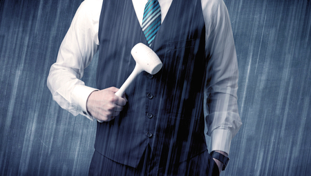 Employer standing with tool on his hand Stock Photo
