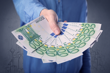 Businessman holding money Archivio Fotografico