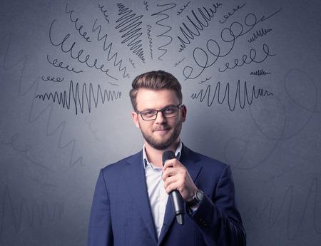 Businessman holding microphone Stock Photo