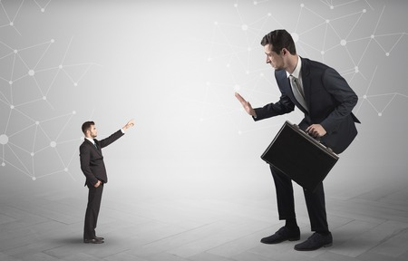 Small man aiming at a big man with network concept