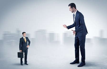 Giant businessman is  afraid of small executor