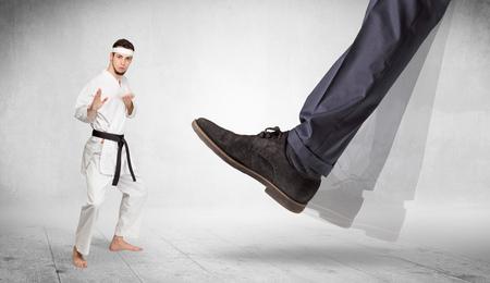 Big foot trample karate trainer concept Archivio Fotografico