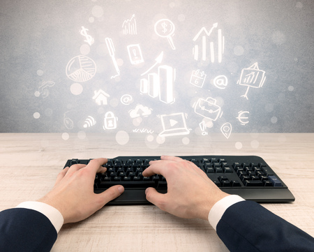 Elegant businessman hand typing with doodle report and chart concept Stockfoto