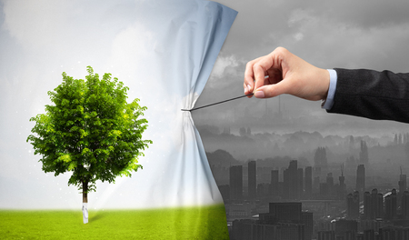hand pulling nature cityscape curtain to gray cityscape Stockfoto