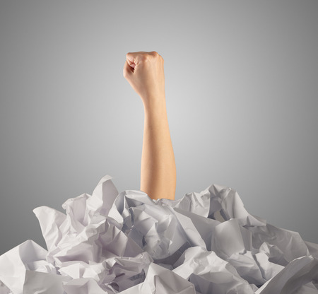 Breaking out from pile of paper Stock Photo