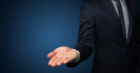 Businessman handing something without concept Banque d'images