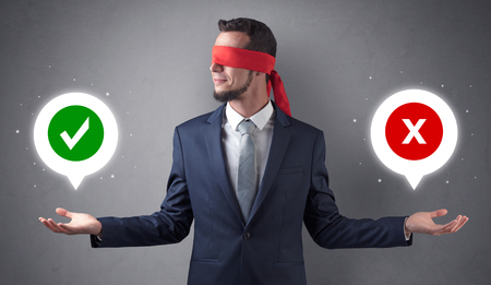 Blindfolded businessman trying to choose Stockfoto