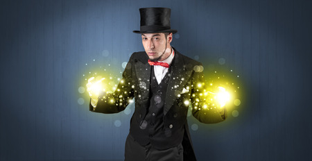 Illusionist holding superpower on his hand 스톡 콘텐츠