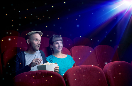 Lovely couple watching 3D movie Stock Photo