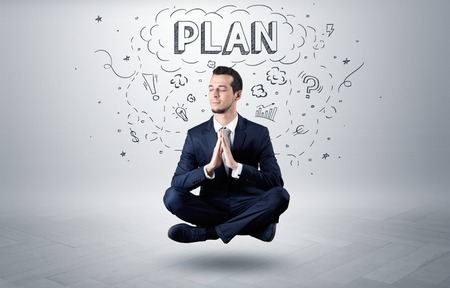 Businessman sitting in yoga position and meditates with doodle concept Stock fotó