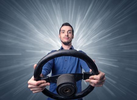 Man holding steering wheel Foto de archivo