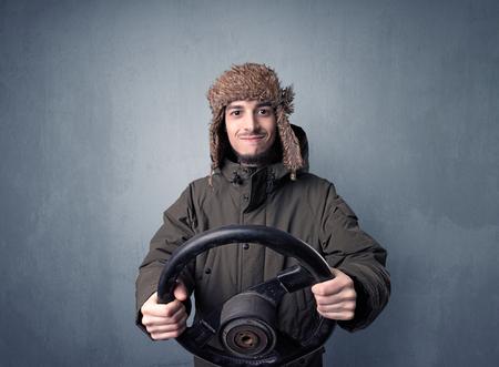 Man holding steering wheel Stok Fotoğraf