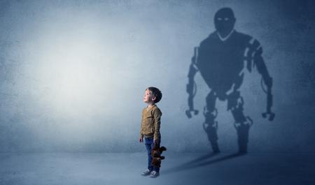 Robotman shadow of a cute little boy Imagens