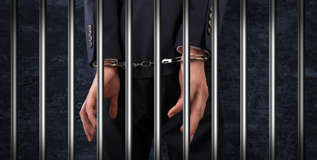Close handcuffed man in jail Standard-Bild - 111659631