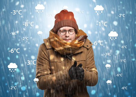 Boy freezing in warm clothing with weather condition concept Stock Photo
