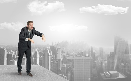 Sleepy businessman on the top of the city Stock Photo