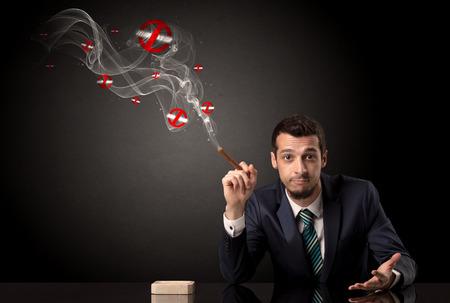Businessman smoking concept Stock Photo