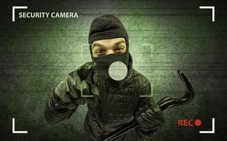 Burglar in action. Imagens