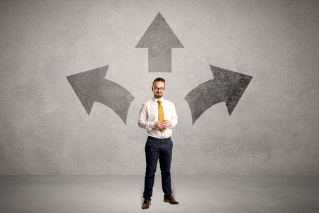 Businessman standing with three arrows Banco de Imagens