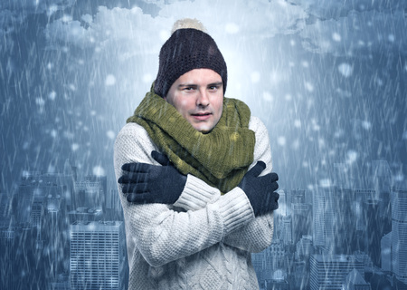 Boy freezing in cold weather with city concept Stock Photo