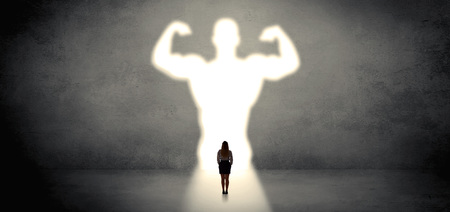 Woman standing in front of a strong hero vision