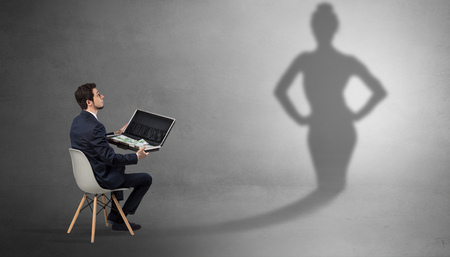 Businessman staying and offering stuffs to a shadow woman