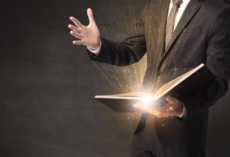Man holding a book. Imagens