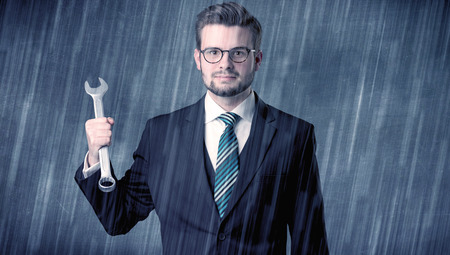 Employer standing with tool on his hand 版權商用圖片