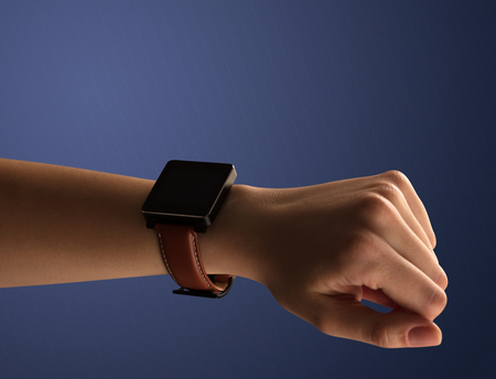 Close up female hand with balck smartwatch screen Stock Photo