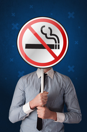 Businessman holding no smoking sign Stock Photo - 112761919