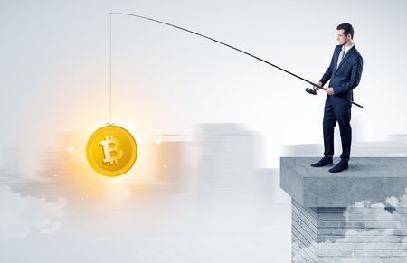 Businessman fishing coins concept