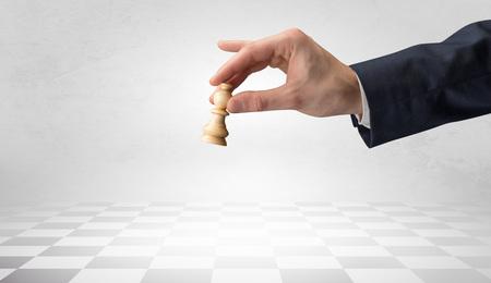 Big hand taking his next step on chess game Фото со стока - 112762065