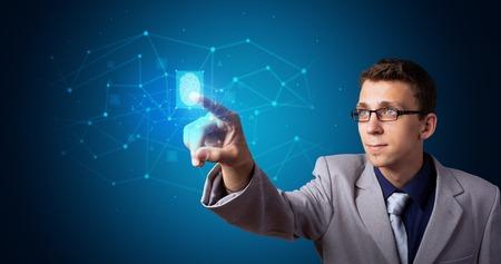 Man accessing hologram with fingerprint