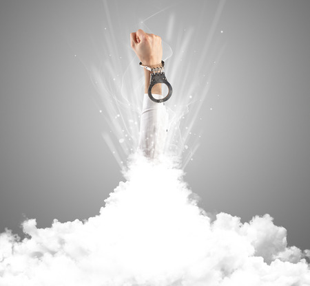 Hand coming out from cloud
