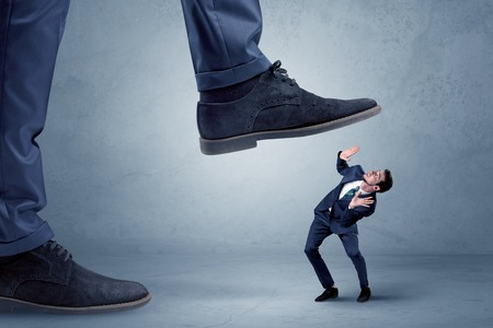 Trampled small businessman in suit