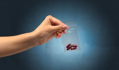 Giving drugs in plastic bag