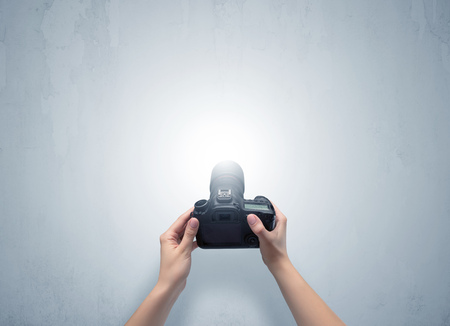 Hand photo shooting an empty grey wall