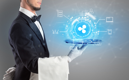 Waiter serving on a tray cryptocurrency and mining concept Stok Fotoğraf