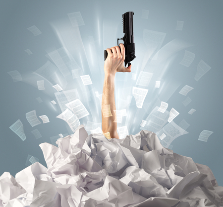 Hand coming out from a huge paper pile