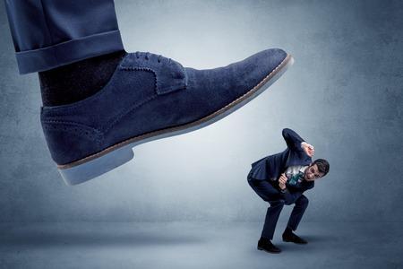Cruel boss tramping his employee Stock Photo