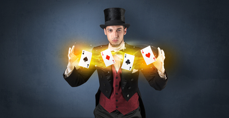 Illusionist making trick with magical play cards Stock fotó